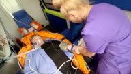 Provide emergency medical care to senior person with symptoms of a heart attack video
