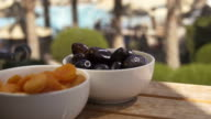 Prunes and apricots on the wood table video