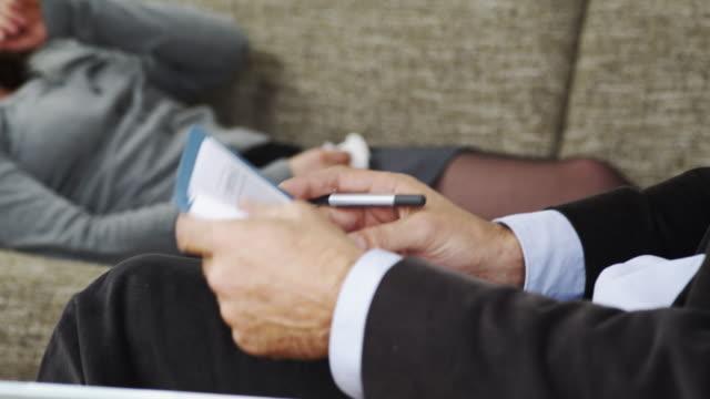 Psychiatrist takes notes video