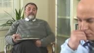 HD DOLLY: Psychiatrist Talking To A Businessman video
