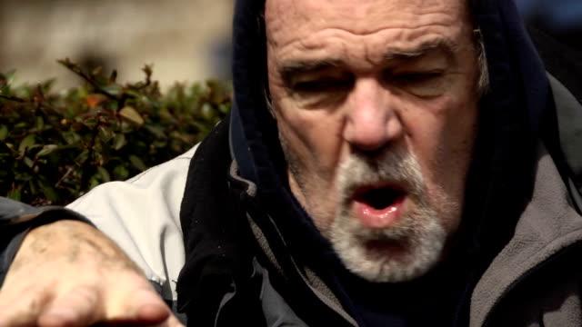 Psychotic Man in Urban Park - CU video