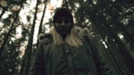 Psychotic woman losing consciousness in the forest video