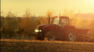Pull focus agricultural tractor farming the land video