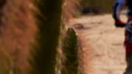 Pull focus from cactus to motocross rider video