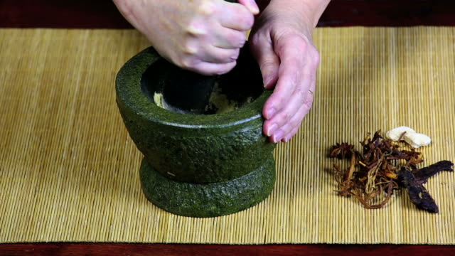 Pulverizing Asian Spices In A Mortar video