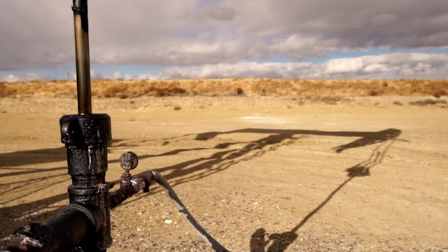 Pump Jack Shaft With Oil Well Shadow Dirt Wyoming video