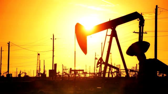Pump Jacks Producing Crude Fossil Fuels video