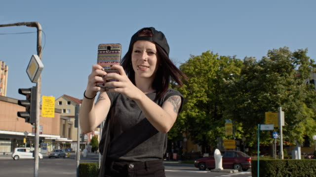 SLO MO Punk girl having a video call in city video