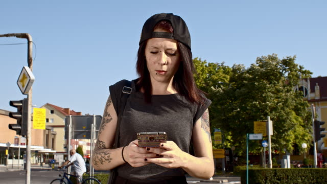 Punk girl using a smartphone in the city video