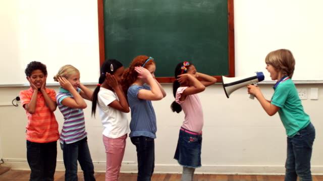 Pupil shouting at his classmates through megaphone video
