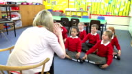Pupils Copying Teacher's Actions Whilst Singing Song video