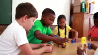 Pupils playing with building blocks in classroom video