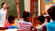 Pupils raising their hands during class video