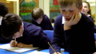 Pupils Sitting At Desks Answering Questions From Teacher video