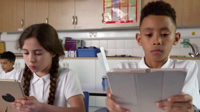 Pupils Sitting At Desks Using Digital Tablets Shot On R3D video