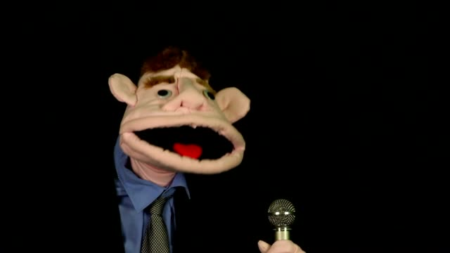 Puppet singing into microphone video