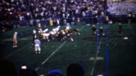 1969: Purdue college football team kicks a field goal scoreboard shows big lead. video