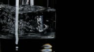 Pure, still water pouring in glass video