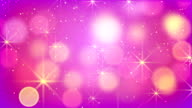 purple bokeh lights and fairy dust loopable background video