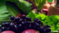purple Grapes with fruits and green vegetables setting on table video