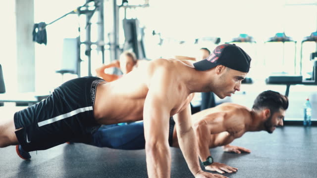 Push up round in a gym. video
