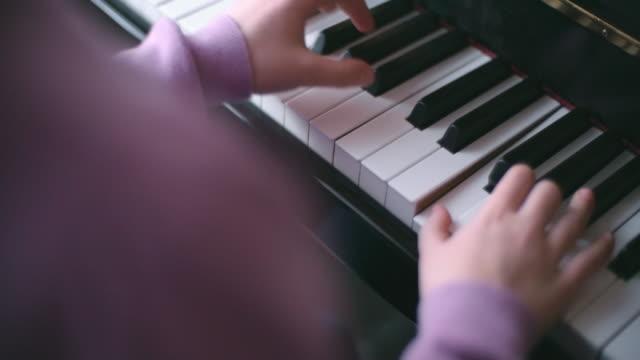 Pushing down piano keys video