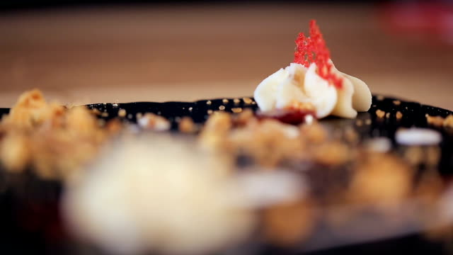 put a red element on creamy star of chocolate Dessert in a restaurant video
