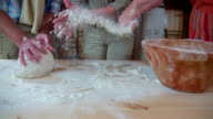 Put flour on the hands so the bough does not stick video