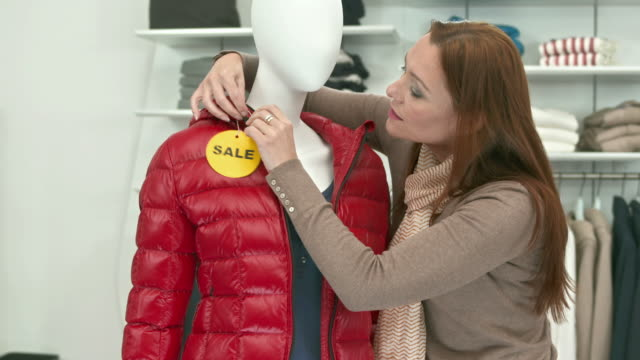 HD DOLLY: Putting A Sale Sign On Clothes video