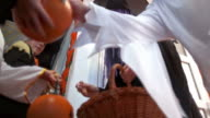 HD: Putting Candy In Halloween Buckets video