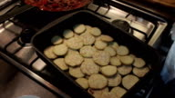Putting chopped aubergine into oven-tray video