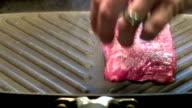 Putting Flank Steak on Grillpan video