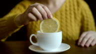Putting lemon into a tea cup video