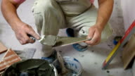 putting mortar on Tile using  trowel video