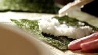 Putting rice on nori. video