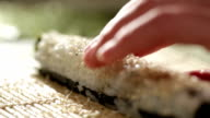 Putting sesame on sushi roll. video