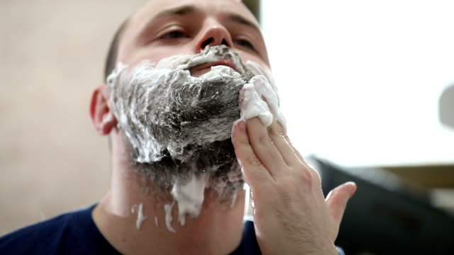 Putting shaving cream on face video