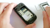 Putting sim card in  Mobile Phone video