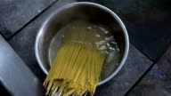 Putting spaghetti into the boiling water video