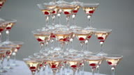Pyramid from glasses with champagne with cherry in glasses video