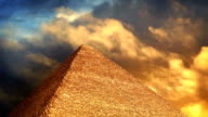Pyramid With Golden Clouds Passing Above video