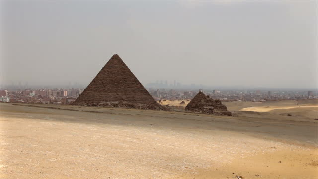 Pyramids on the background of Cairo. Overview from right to video