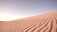 Quad biker on a sand dune in a desert race video