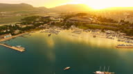 AERIAL Quad scull approaching city on the coast video