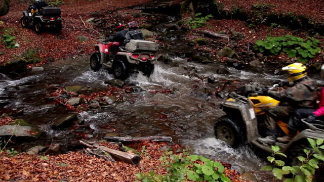 quadbikes crossing river video