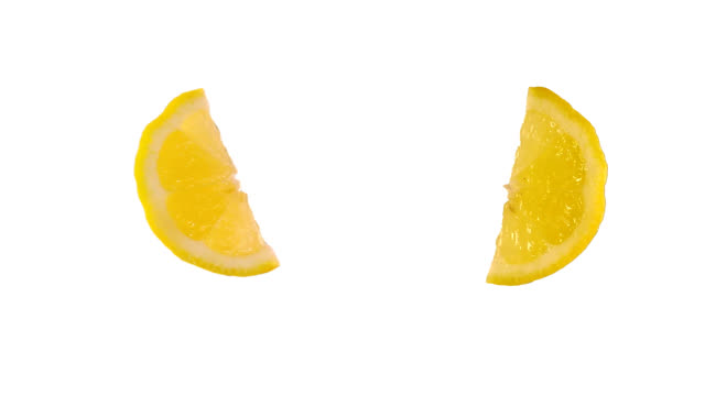 Quarter of lemon isolated on white. Luma included. video