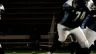 Quarterback draws back for a pass video