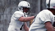 Quarterback prepares for the snap. video