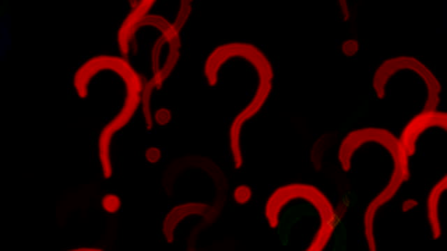 Question marks. Out of focus lights background video