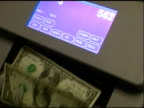 Quick count. Cash money counting machine.Hundred dollar bills. video